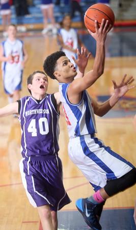 2-18-15<br /> City-County basketball game Kokomo Blue vs Northwestern<br /> Kokomo's Josiah Matthews shoots.<br /> Kelly Lafferty Gerber | Kokomo Tribune