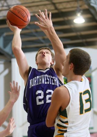 2-20-15<br /> Eastern vs Northwestern basketball<br /> Northwestern's Quinlan Armstrong puts up a shot.<br /> Kelly Lafferty Gerber | Kokomo Tribune