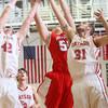 2-26-15<br /> Taylor vs Maconaquah basketball<br /> Taylor's Donovan Renbarger and Jerrad Moore, and Maconaquah's Ben Stephenson go for a rebound.<br /> Kelly Lafferty Gerber | Kokomo Tribune