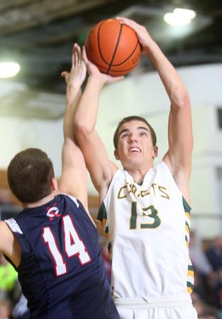 2-12-15<br /> Eastern vs Cass basketball<br /> Eastern's Braden Evans shoots.<br /> Kelly Lafferty Gerber | Kokomo Tribune