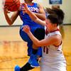 Taylor HS hosting Kokomo HS girls basketball on Monday Feb, 3, 2015. KHS's Quaynika Marriweather going up for a shot with THS's Hannah Mullinax fouling her.<br /> Tim Bath | Kokomo Tribune