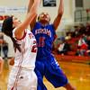 Taylor HS hosting Kokomo HS girls basketball on Monday Feb, 3, 2015. THS's Shaelah Eliason and KHS's Jayda Andrews going for a rebound on a Kokomo shot.<br /> Tim Bath | Kokomo Tribune