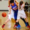 Taylor HS hosting Kokomo HS girls basketball on Monday Feb, 3, 2015. KHS's Gabrielle Smith getting sandwiched between THS's Brie Boehler and Savannah Delgado.<br /> Tim Bath   Kokomo Tribune