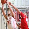 2-26-15<br /> Taylor vs Maconaquah basketball<br /> Taylor's Jerrad Moore and Maconaquah's Luke Hann go after a rebound.<br /> Kelly Lafferty Gerber | Kokomo Tribune