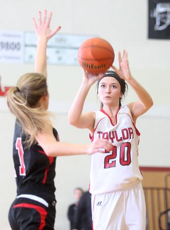 2-11-15<br /> Taylor vs Sheridan basketball<br /> Taylor's Shaelah Eliason goes for the basket.<br /> Kelly Lafferty Gerber | Kokomo Tribune