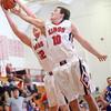 2-24-15<br /> Tipton vs Cass basketball<br /> Cass' Ty Stover and Owen Ohman go for the rebound.<br /> Kelly Lafferty Gerber | Kokomo Tribune