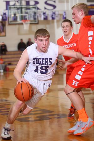 2-17-15<br /> Northwestern vs Hamilton Heights basketball<br /> Northwestern's Jacob Wagner dribbles around Hamilton Heights.<br /> Kelly Lafferty Gerber | Kokomo Tribune