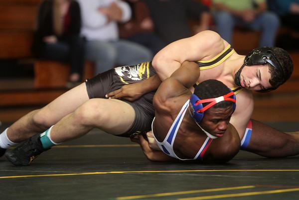 2-7-15<br /> Regional Wrestling<br /> Peru's Jordan Rader vs Kokomo's DaShaun Barbary in the 160.<br /> Kelly Lafferty Gerber | Kokomo Tribune