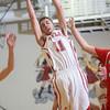 2-26-15<br /> Taylor vs Maconaquah basketball<br /> Taylor's Darian Stone snatches up a rebound.<br /> Kelly Lafferty Gerber | Kokomo Tribune