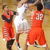 2-27-15<br /> Kokomo vs Northrop basketball<br /> Kokomo's Jordan Matthews tries to pass over Northrop's defense.<br /> Kelly Lafferty Gerber | Kokomo Tribune