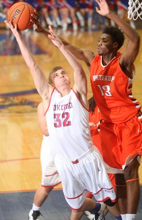 2-27-15<br /> Kokomo vs Northrop basketball<br /> Kokomo's Kyle Wade shoots as Northrop's Aaron Thomas fouls him.<br /> Kelly Lafferty Gerber | Kokomo Tribune