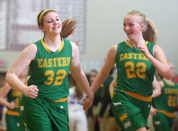 2-13-15<br /> Eastern vs Elwood<br /> Eastern's Ashlynn Hochstedler cheers up Taylor Holliday after Eastern loses.<br /> Kelly Lafferty Gerber   Kokomo Tribune