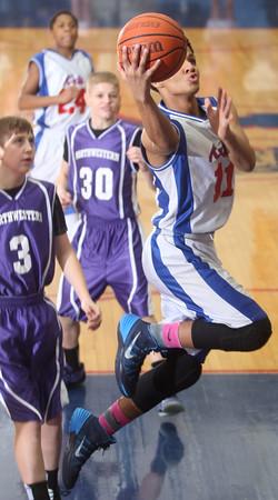 2-18-15<br /> City-County basketball game Kokomo Blue vs Northwestern<br /> Kokomo's Josiah Matthews jumps to the basket.<br /> Kelly Lafferty Gerber | Kokomo Tribune