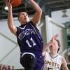 2-20-15<br /> Eastern vs Northwestern basketball<br /> Northwestern's Austin Miller shoots.<br /> Kelly Lafferty Gerber | Kokomo Tribune