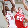 2-26-15<br /> Taylor vs Maconaquah basketball<br /> Taylor's Dontae Campbell shoots.<br /> Kelly Lafferty Gerber | Kokomo Tribune