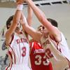 2-26-15<br /> Taylor vs Maconaquah basketball<br /> Taylor's Malin Vazquez and Donovan Renbarger go after a rebound.<br /> Kelly Lafferty Gerber | Kokomo Tribune