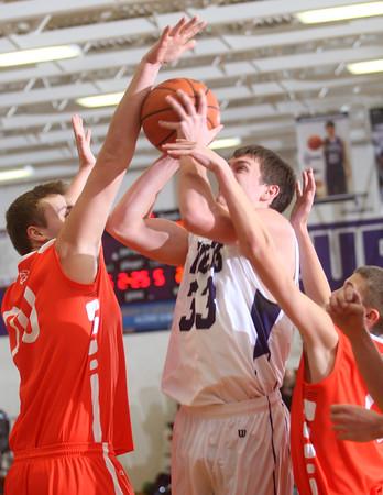 2-17-15<br /> Northwestern vs Hamilton Heights basketball<br /> Northwestern's Derek Doubet tries to shoot over Hamilton Heights.<br /> Kelly Lafferty Gerber   Kokomo Tribune
