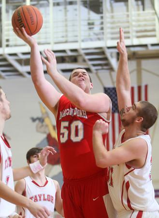 2-26-15<br /> Taylor vs Maconaquah basketball<br /> Maconaquah's Ben Stephenson shoots.<br /> Kelly Lafferty Gerber | Kokomo Tribune