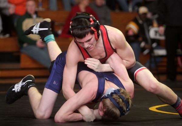 2-7-15<br /> Regional Wrestling<br /> Taylor's Chad Elmore vs Oak Hill's Nate Shelton in the 120.<br /> Kelly Lafferty Gerber | Kokomo Tribune