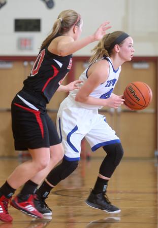 2-13-15<br /> Tipton vs Sheridan<br /> Tipton's Macie Lively looks for a pass around Sheridan's defense.<br /> Kelly Lafferty Gerber | Kokomo Tribune