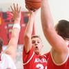 2-26-15<br /> Taylor vs Maconaquah basketball<br /> Maconaquah's Wyatt Hughes looks for a pass.<br /> Kelly Lafferty Gerber | Kokomo Tribune
