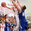 2-24-15<br /> Tipton vs Cass basketball<br /> Cass' Evan Ohman shoots.<br /> Kelly Lafferty Gerber | Kokomo Tribune