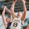 2-20-15<br /> Eastern vs Northwestern basketball<br /> Eastern's Braden Evans and Northwestern's Jacob Wagner go up for a rebound.<br /> Kelly Lafferty Gerber | Kokomo Tribune