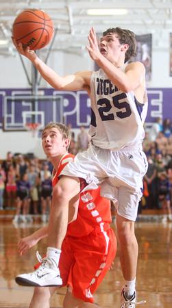 2-17-15<br /> Northwestern vs Hamilton Heights basketball<br /> Northwestern's Riley Hudson shoots.<br /> Kelly Lafferty Gerber | Kokomo Tribune