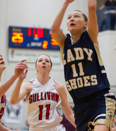 Teutopolis' Molly Smith puts up a layup in the closing seconds of the Class 2A Pana Regional title game against Sullivan.