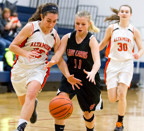 Altamont's Tinley Mette steals the ball away from North Clay's Bailey Walters while teammate Shelbi Stone trails from behind at the Class 1A South Central Regional.