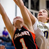 Brownstown/St. Elmo's Elizabeth Johnson vies for the rebound over Ramsey's Delainey Enloe.