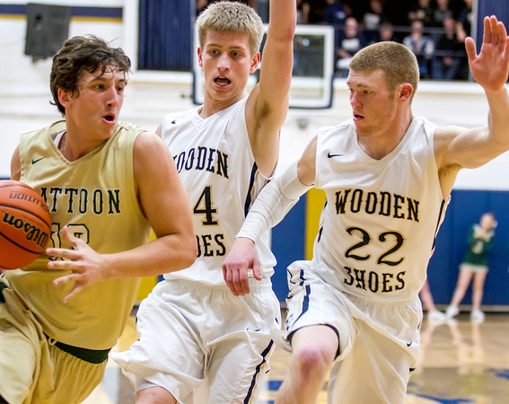 Teutopolis' Kyle Smith (center) and Blake Mette (right) guard Mattoon's Nick Poorman during a game at Teutopolis High School earlier this month.