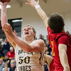 Teutopolis' Brett Mette gets past Warrensburg-Latham's Weston Nottelmann. Mette led the Shoes in scoring with 13.