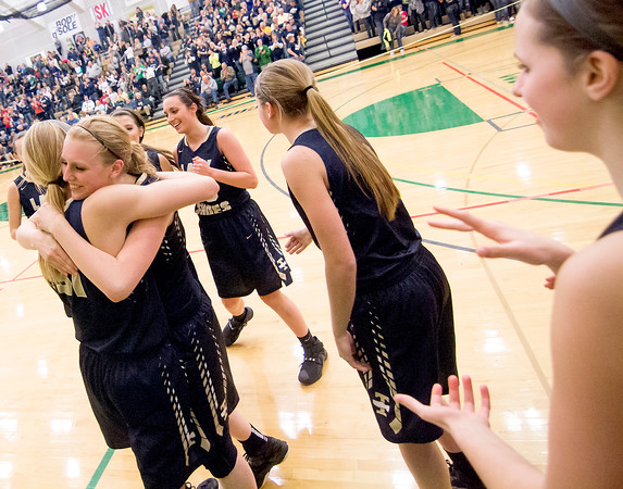 Teutopolis teammates Jamie Sandschafer and Anna Hartke (left) hug after defeating Bloomington Central Catholic at the Class 2A Parkland Super-Sectional.