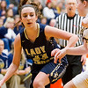 Teutopolis' Shelby Thompson looks for an opening in the Tuscola defense at the Class 2A Pana Sectional final.