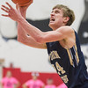 Teutopolis' Kyle Smith eyes the glass during a game at St. Anthony.
