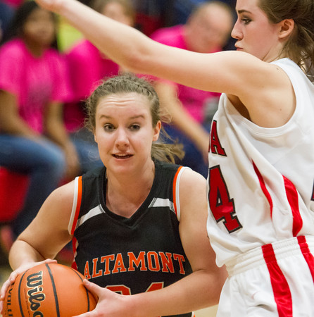 Altamont's Ashley Goeckner tries to drive past Neoga's Blair Banning.