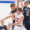 St. Anthony's Kyle Hartke passes the ball outside as Teutopolis' Devin Smith (10) and Kyle Smith (center) try to prevent a shot.