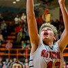 Altamont's Sam Childerson puts up the bucket while Windsor/Stew-Stras' Chase Thies watches from behind.