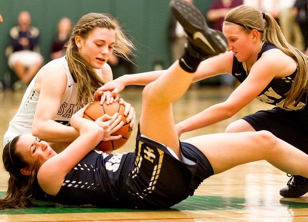Teutopolis' Shelby Thompson (center) and Danielle Repking (right) vie for possession against Bloomington Central Catholic's Sarah Brady (left) at the Class 2A Parkland Super-Sectional.