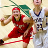 Effingham's Carsyn Fearday attempts to box out Civic Memorial's Allie Troeckler.