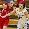 St. Anthony's Abby Weis guards Brownstown/St. Elmo's Gabi Moore at Brownstown High School.