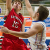 Effingham's Sean Zerrusen puts a hook shot up over the defense of Newton's Brock Mammoser.