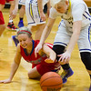 St. Anthony's Emily McDevitt and Brownstown/St. Elmo's Morgan Brown fight for a loose ball at Brownstown High School.