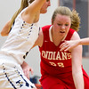Teutopolis' Anna Hartke keeps Lawrenceville's Brianna Meffod away from the basket. Hartke and her fellow Shoes' defense held the Indians to single-digit scoring in each quarter.