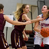St. Anthony's Olivia Clausius prepares to pull up in front of Dieterich's Kyla Johnson and Kaitlyn Bloemer (20).