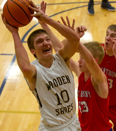 Teutopolis' Brant Bueker eyes the basket inside the paint as St. Anthony's Alex Deters tries to defend. Bueker led all scorers with 24 points.