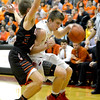 St. Anthony's Drew Gibson drives to the basket against Altamont's Mitchell Stevenson in the Class 1A Nokomis Sectional semifinal.