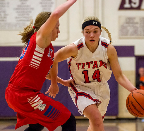 St. Anthony's Abby Weis, left, tries to keep up with Tri-County's Shayne Smith during the Class 1A Arcola Sectional semifinal. Smith finished with 21 points to lead the Titans over the Bulldogs 51-43.