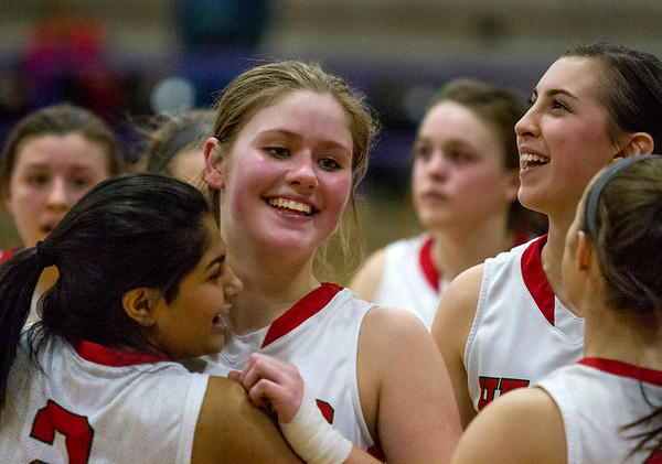 Effingham's Aly Armstrong, center, and Riya Shah embrace while Sidney Webster, right, smiles following the Hearts' 70-64 win over Lincoln for the Class 3A Taylorville Regional championship.